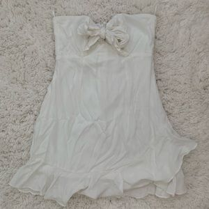 white mini summer dress with ruffle bottom